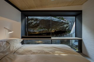 An Arresting Australian Abode by Glenn Murcutt Needs a Buyer - Photo 7 of 8 - The rock ledge provides natural privacy from the street and ensconces occupants in the site's beauty.