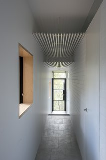 An Arresting Australian Abode by Glenn Murcutt Needs a Buyer - Photo 4 of 8 - Passageways take advantage of the southern side of the house, so that living areas and bedrooms receive northern sunlight. White walls are satin-finished or bagged brickwork.