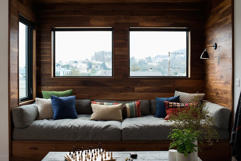 A walnut wrapped cozy built-in living area window seat.  Chenery Street Remodel by SF Design Build