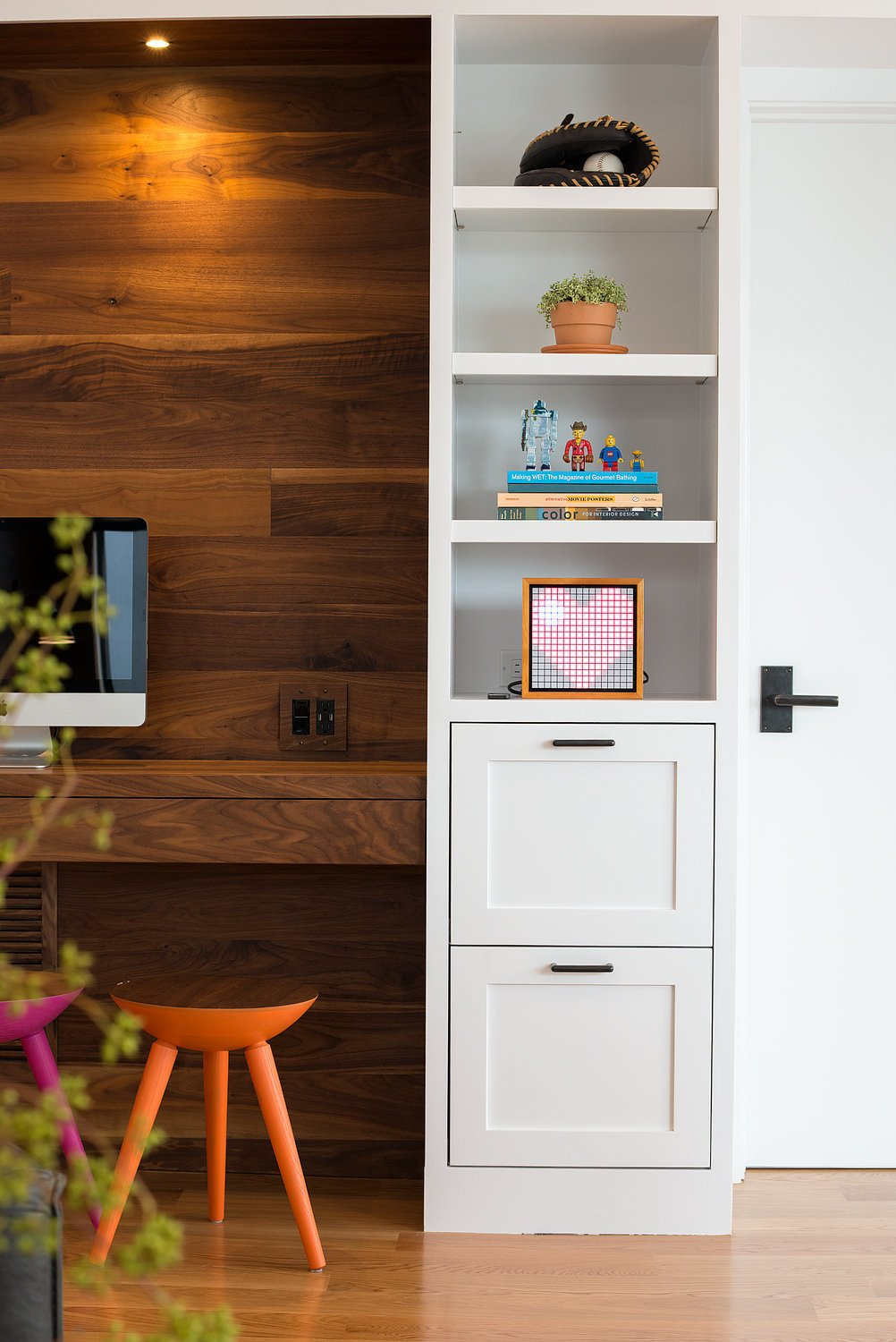 A full wall of built-in storage cabinets accented with walnut and oil-rubbed bronze hardware.  Chenery Street Remodel by SF Design Build