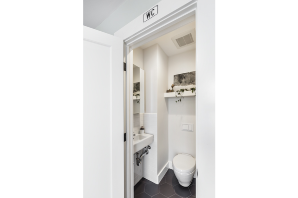 Modern home with bath room. By reconfiguring a closet and full bathroom, a new powder room was added off the entry.  Photo 5 of 14th Avenue Remodel