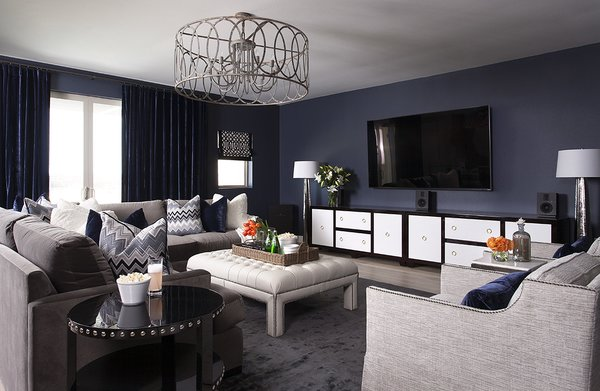 Quiet, spacious media room with deep hues to set the mood.  Photo 4 of Austin Urban Townhome modern home