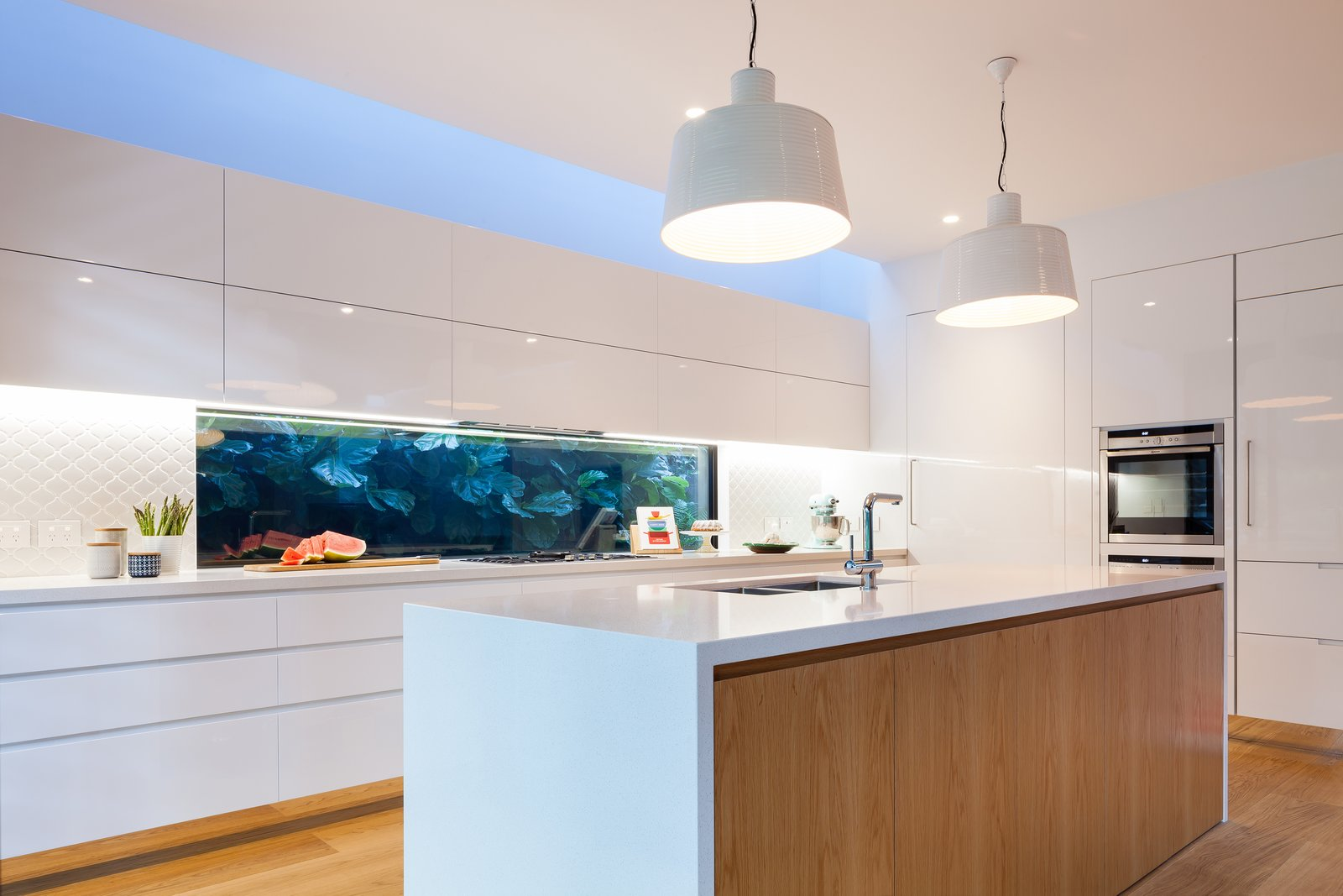 Kitchen with Green wall splashback  Castlecrag House by Gerard Page