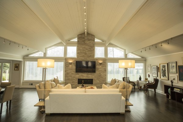 The living space transformed into a light airy and voluminous area for entertaining. Photo  of The R.D. House modern home