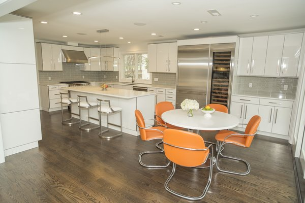 The kitchen which flow right from the Living Room. Updated to a new white sleek look. Photo 4 of The R.D. House modern home