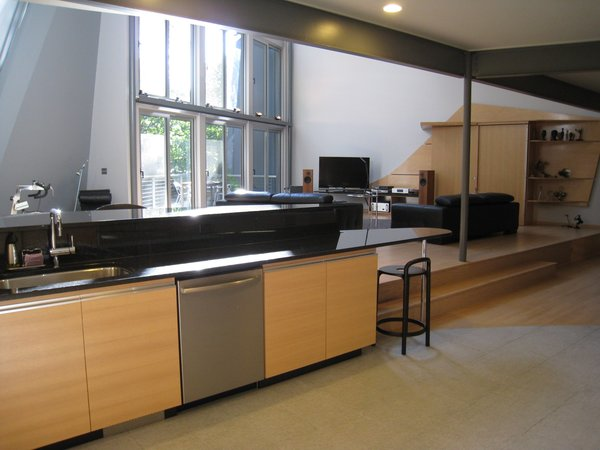 looking SW from kitchen: entertainment center (oak doors, oak plywood, plastic laminate tops, perforated aluminum) is on right.   Photo 12 of metalHOUSE(2) modern home