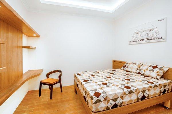 Modern home with bedroom, chair, ceiling lighting, table lighting, shelves, bed, and ceramic tile floor. Photo 4 of Prawirotaman Street