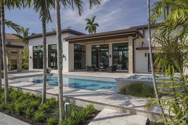 Modern home with outdoor, back yard, large patio, porch, deck, hardscapes, and pavers patio, porch, deck. Photo 3 of Sunrise Key Residence