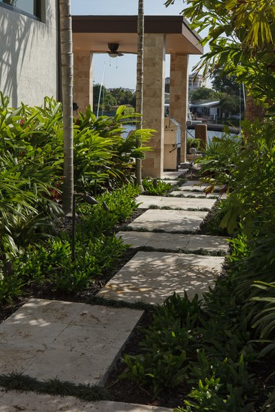 Modern home with outdoor and side yard. Photo 10 of Sunrise Key Residence