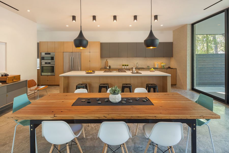 Dining/Kitchen Tagged: Kitchen, Engineered Quartz Counter, Wood Cabinet, Porcelain Tile Backsplashe, Refrigerator, Accent Lighting, Cooktops, and Wall Oven.  Pavilion Haus by studioMET architects
