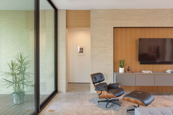Modern home with living room, chair, recliner, and concrete floor. Living Room Photo 20 of Pavilion Haus