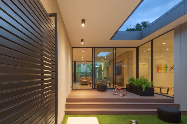 Modern home with outdoor, grass, wood patio, porch, deck, pavers patio, porch, deck, concrete patio, porch, deck, front yard, and walkways. Entry Courtyard Photo  of Pavilion Haus