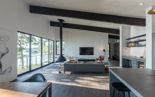 Modern home with hanging fireplace and living room. Photo 2 of Lakefront