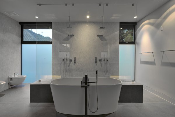Modern home with bath room, freestanding tub, and open shower. Photo 8 of Underwood