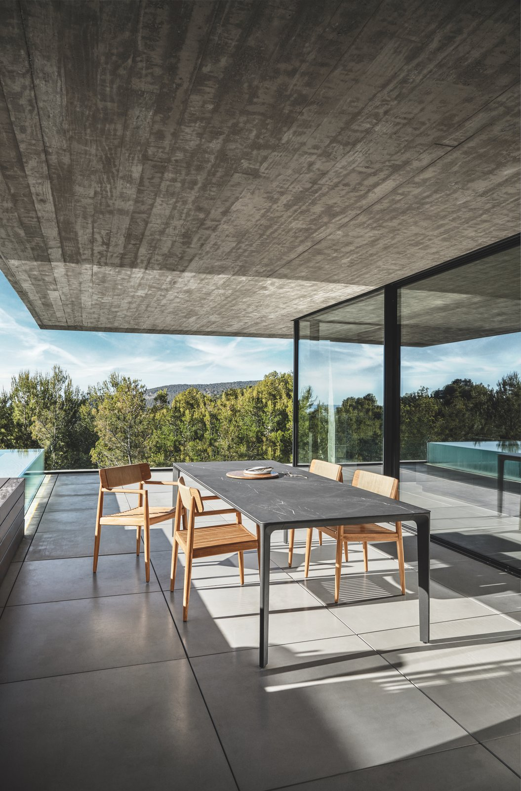 Dining with a Scandinavian touch: Archi dining chair combined with Carver table. Tagged: Table, Chair, Concrete, Outdoor, Trees, Large, Back Yard, Infinity, Concrete, Swimming, Large, and Hardscapes.  Best Outdoor Chair Infinity Large Photos from Dining Chairs