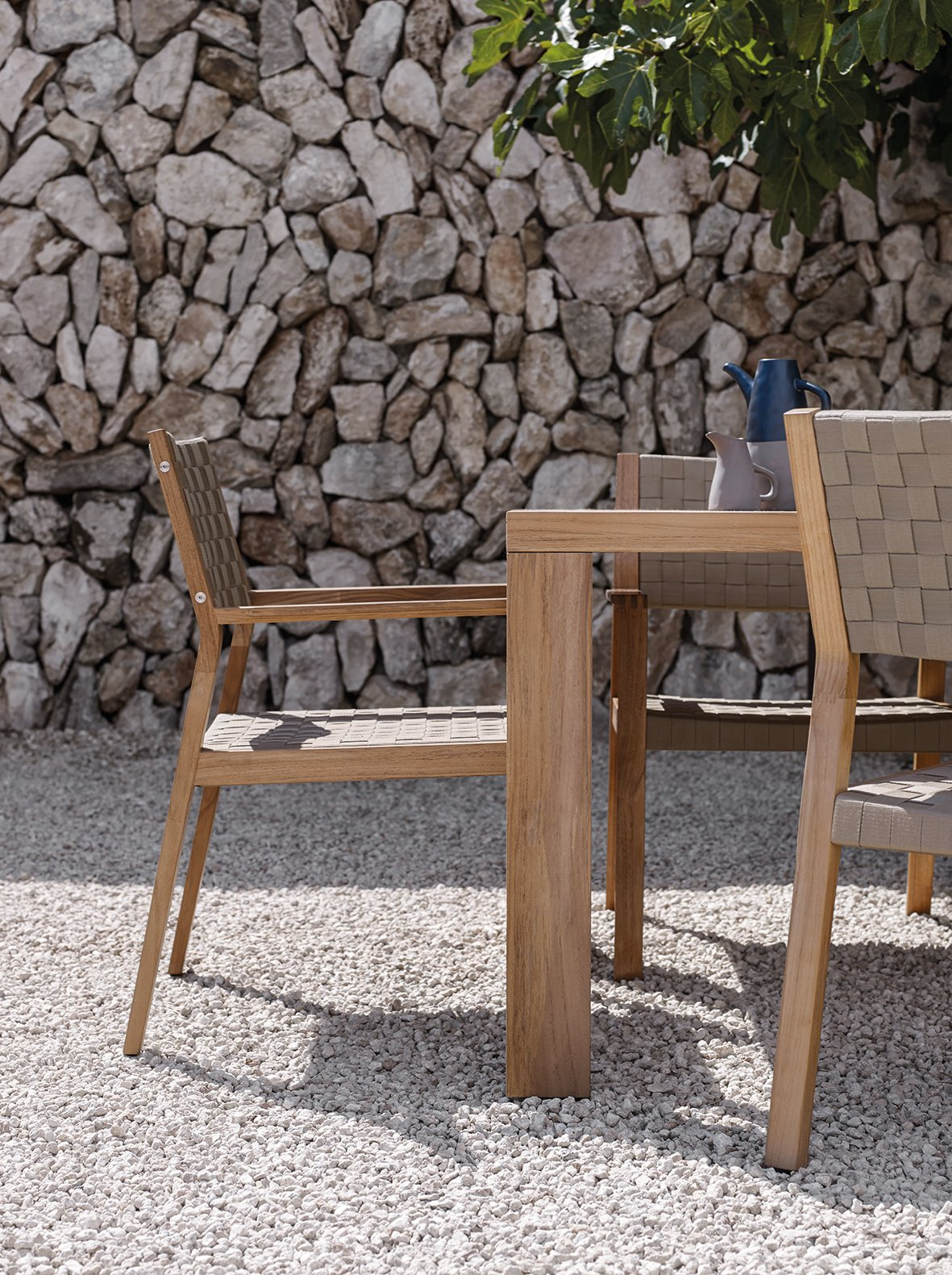 Working with soft outdoor straps woven over angular, teak frames, Maze's unique design offers both visual impact and exceptional comfort. Tagged: Table, Chair, Outdoor, Back Yard, Trees, Hardscapes, Stone Patio, Porch, Deck, Large Patio, Porch, Deck, and Small Patio, Porch, Deck.  Dining Chairs by Gloster Furniture