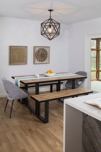 The dining room features an industrial white oak table and benches with matte black steel frame, a geometric chandelier by Bobo Intriguing objects, and shaved wood art pieces by West Elm.  Photo 6 of St. Johns House modern home