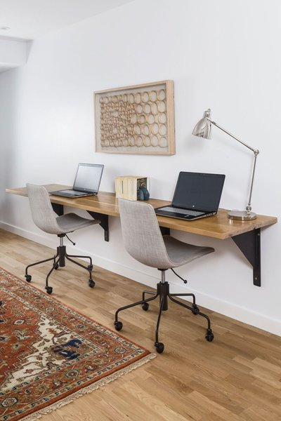 The family study features a 9 foot floating white oak desk with custom L-beam brackets by A. R. Lucas Construction. Photo 8 of St. Johns House modern home