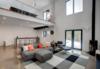 Walkout Basement Living Room Photo  of The Raven Home modern home