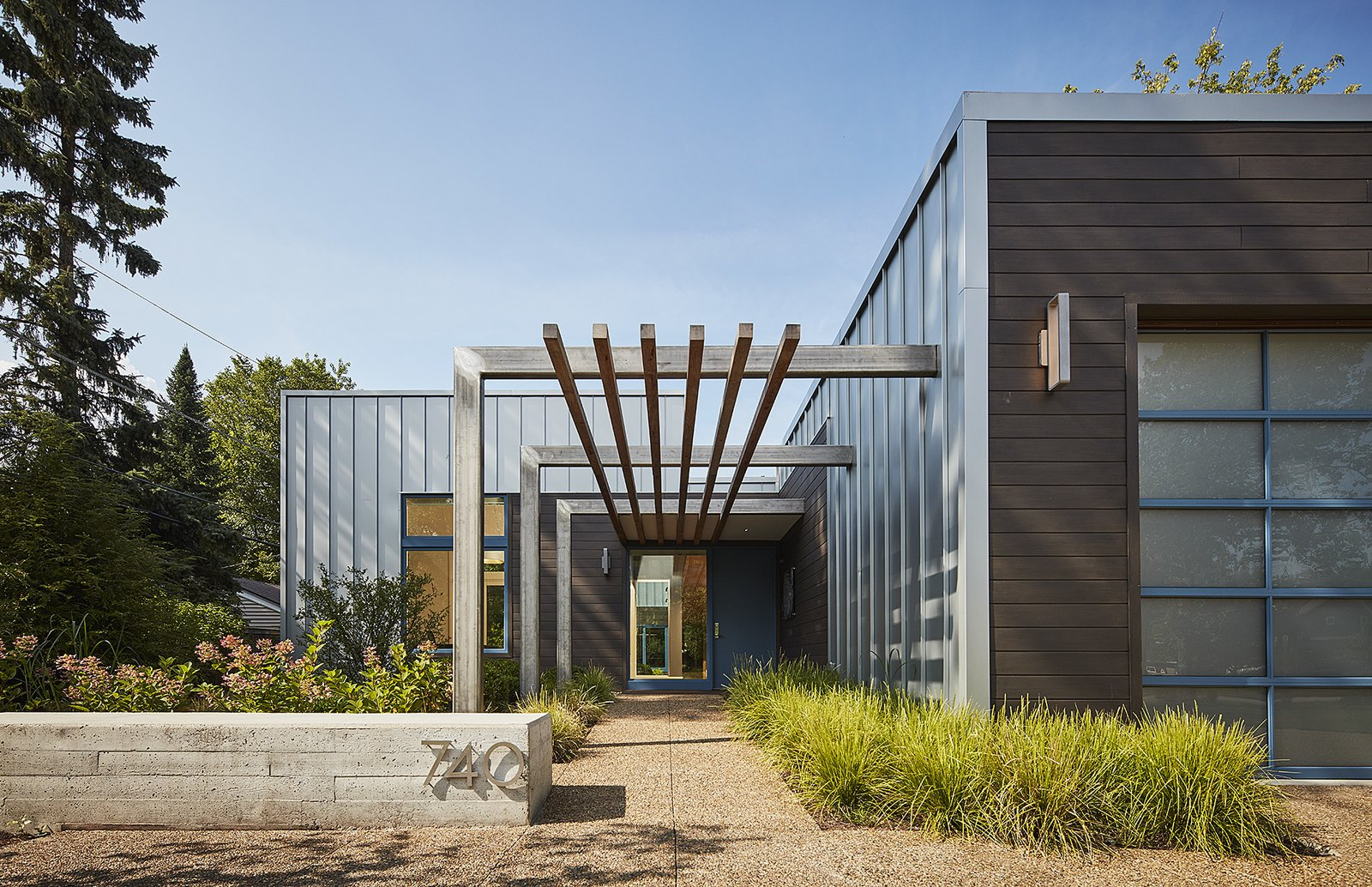 south elevation Tagged: Outdoor, Front Yard, and Concrete Patio, Porch, Deck.  Courtyard Residence by Kuklinski + Rappe Architects