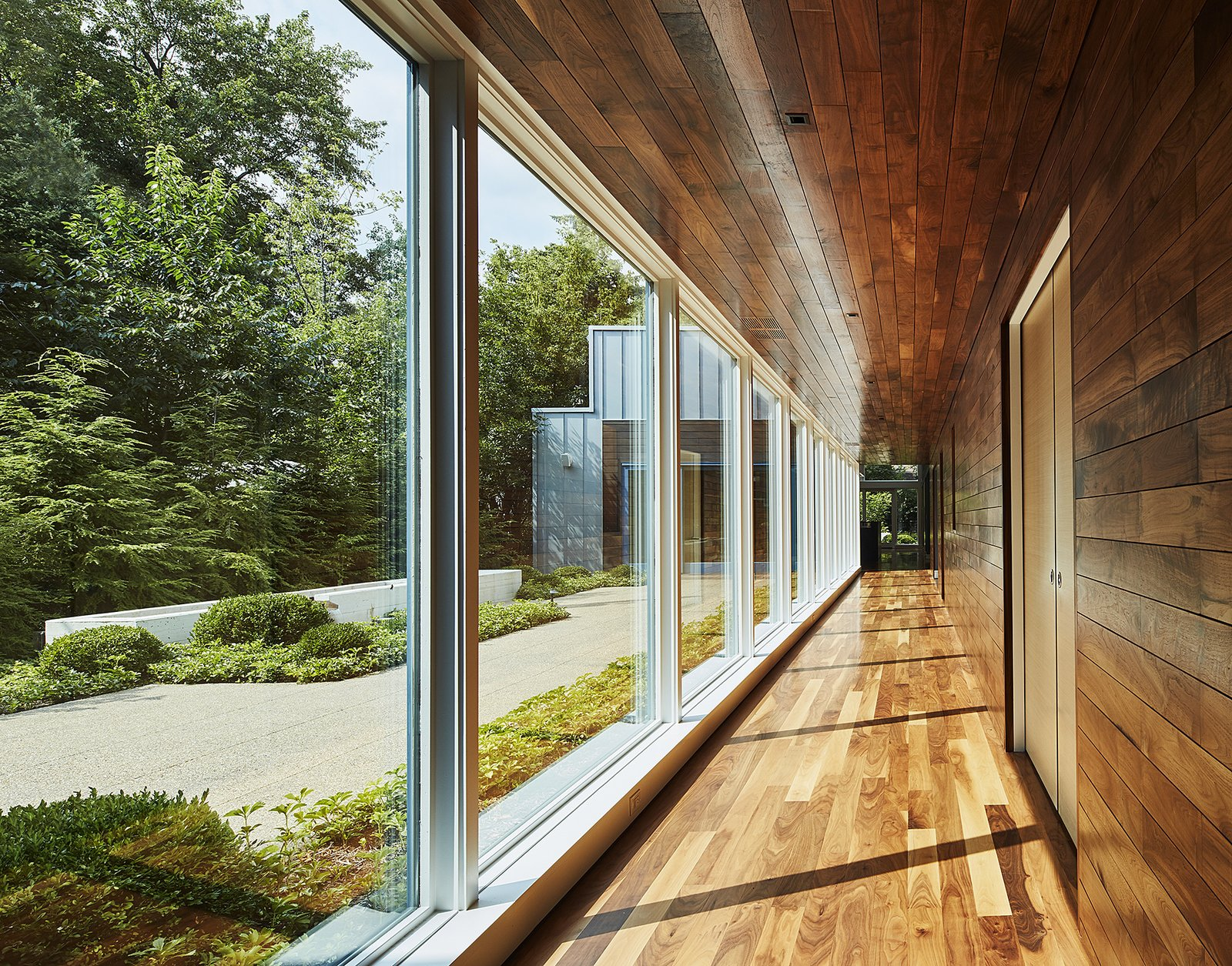 hallway looking south Tagged: Hallway and Medium Hardwood Floor.  Courtyard Residence by Kuklinski + Rappe Architects