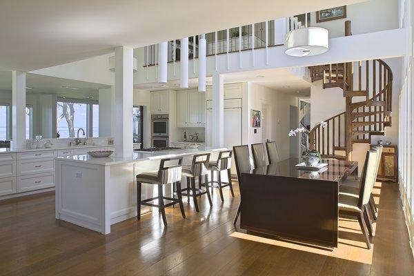 Modern home with dining room, table, stools, chair, ceiling lighting, accent lighting, bar, pendant lighting, and medium hardwood floor. Photo 14 of Destin Residence