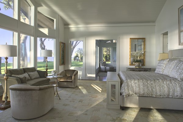 Modern home with bedroom, bed, wardrobe, dresser, night stands, bench, chair, accent lighting, table lighting, and medium hardwood floor. Photo 20 of Destin Residence