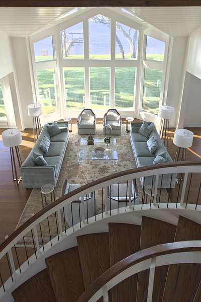 Modern home with living room, chair, sofa, coffee tables, accent lighting, end tables, and medium hardwood floor. Photo 11 of Destin Residence