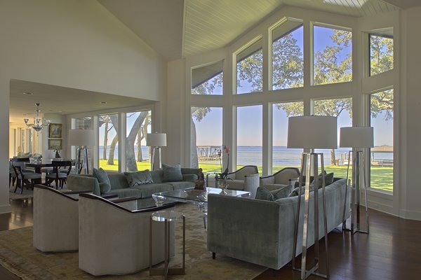 Modern home with living room, chair, medium hardwood floor, accent lighting, sofa, coffee tables, and end tables. Photo 7 of Destin Residence
