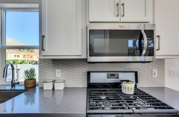 Quartz Counter tops, custom back splash - Palm Canyon Mobile Club Photo 11 of Tiny Homes in Palm Springs modern home