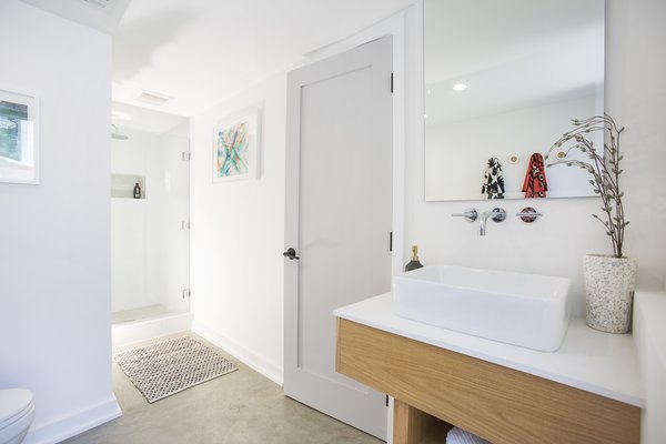 Modern home with bath room, engineered quartz counter, concrete floor, vessel sink, two piece toilet, and enclosed shower. Photo 13 of Silverlake on Riverside Terrace