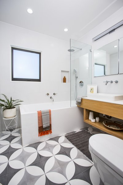 Modern home with bath room, concrete floor, engineered quartz counter, corner shower, vessel sink, wall lighting, recessed lighting, ceramic tile wall, ceiling lighting, soaking tub, and one piece toilet. Photo 10 of Silverlake on Riverside Terrace