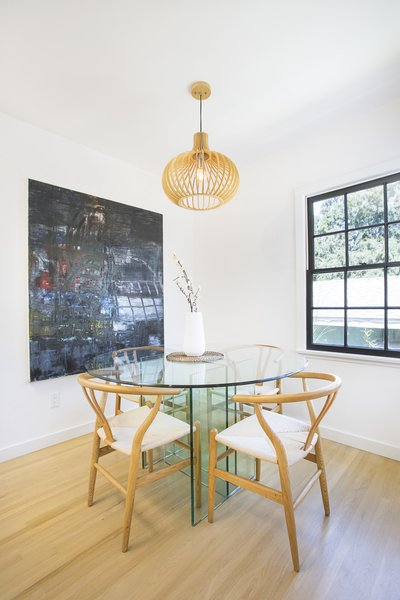 Modern home with dining room, ceiling lighting, table, chair, and light hardwood floor. Photo 6 of Silverlake on Riverside Terrace
