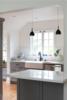 Modern home with Kitchen, Colorful Cabinet, Engineered Quartz Counter, Ceiling Lighting, Recessed Lighting, Wood Cabinet, Light Hardwood Floor, Stone Tile Backsplashe, and Dishwasher. Photo  of SilverLake Kitchen Update
