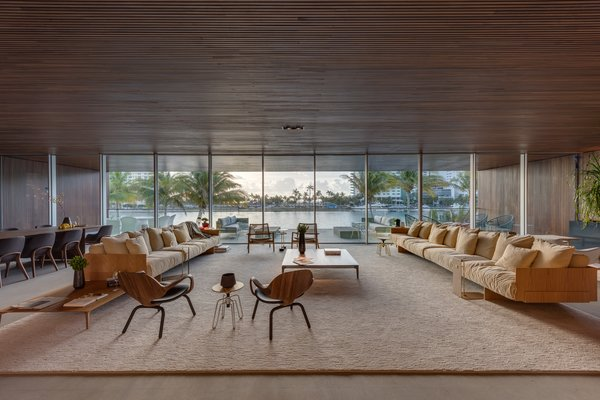 The living room features lots of seating for entertaining and unobstructed views of the water.