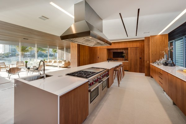 Spacious and bright, the kitchen features a large island with seating and opens up to the living area.
