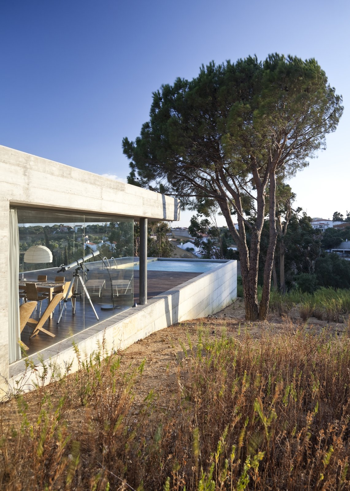 Tagged: Outdoor, Side Yard, Large Patio, Porch, Deck, Grass, Concrete Patio, Porch, Deck, and Wood Patio, Porch, Deck.  House in Pedrogão by Phyd Arquitecura