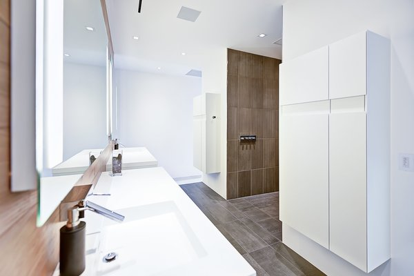 Modern home with hardscapes, walkways, large patio, porch, deck, planters patio, porch, deck, decking patio, porch, deck, horizontal fence, grass, shrubs, trees, boulders, sectional, concrete floor, bed, front yard, night stands, wall lighting, ceiling lighting, and bath room. master bath Photo 10 of Atlantic Beach Modern