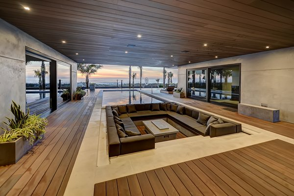 Modern home with back yard, large patio, porch, deck, hardscapes, small pool, walkways, concrete pool, planters patio, porch, deck, decking patio, porch, deck, horizontal fence, and outdoor. Covered deck, sunken fire pit, and pool Photo 2 of Atlantic Beach Modern