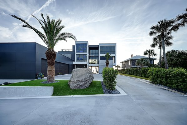Modern home with walkways, decking patio, porch, deck, hardscapes, large patio, porch, deck, planters patio, porch, deck, horizontal fence, grass, shrubs, trees, front yard, side yard, and outdoor. street facing facade Photo 7 of Atlantic Beach Modern