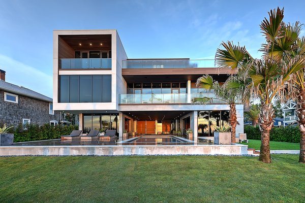 Modern home with back yard, hardscapes, walkways, small pool, concrete pool, planters patio, porch, deck, decking patio, porch, deck, horizontal fence, swimming pool, large patio, porch, deck, and outdoor. Ocean facing facade Photo 5 of Atlantic Beach Modern