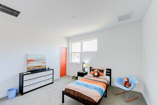 Modern home with bedroom. kid's bedroom Photo  of Cedarbrook Net Zero Modern