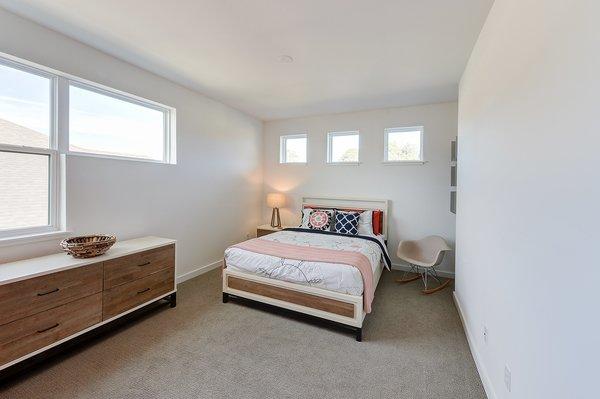 Modern home with bed, chair, dresser, table lighting, carpet floor, and bedroom. guest bedroom Photo 2 of Cedarbrook Net Zero Modern