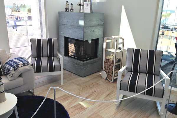 Modern home with living room, bookcase, wood burning fireplace, corner fireplace, storage, and shelves. fleimio trolley in the living room. Photo  of Villa Albatrossi