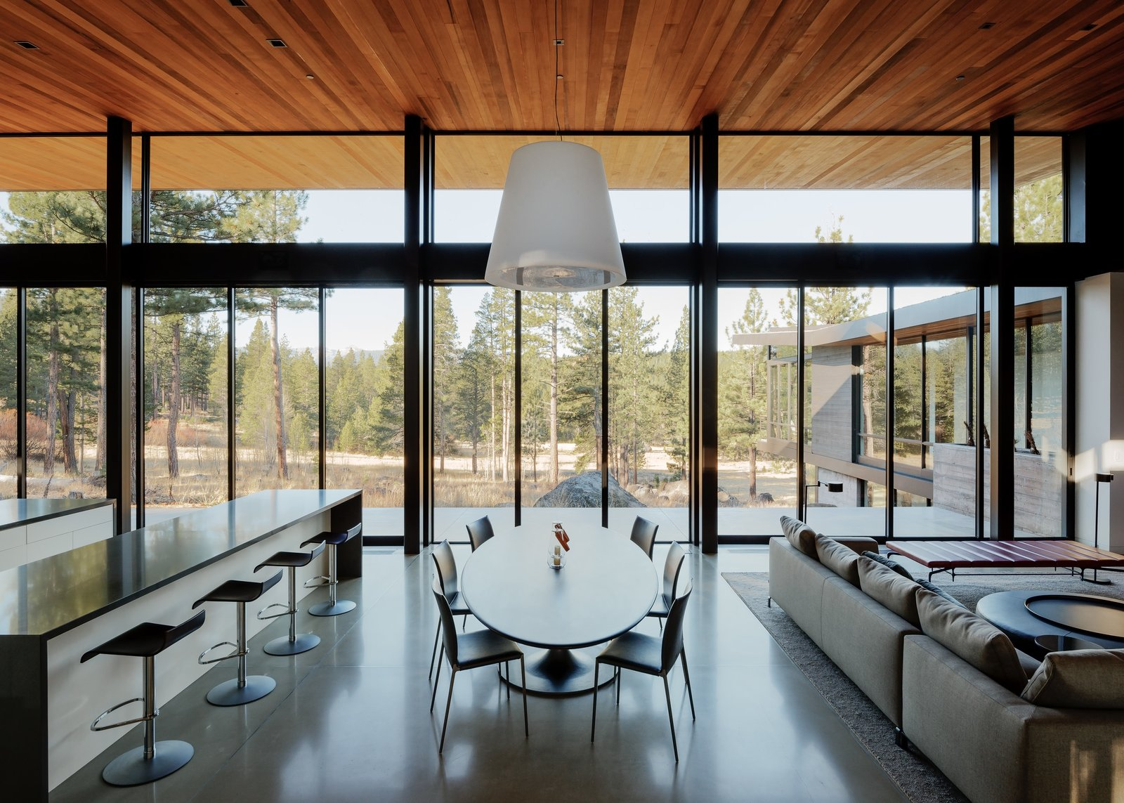 Dining Room Tagged: Dining Room, Pendant Lighting, Concrete Floor, Table, Chair, and Stools. Martis Camp Residence 1 by John Maniscalco Architecture