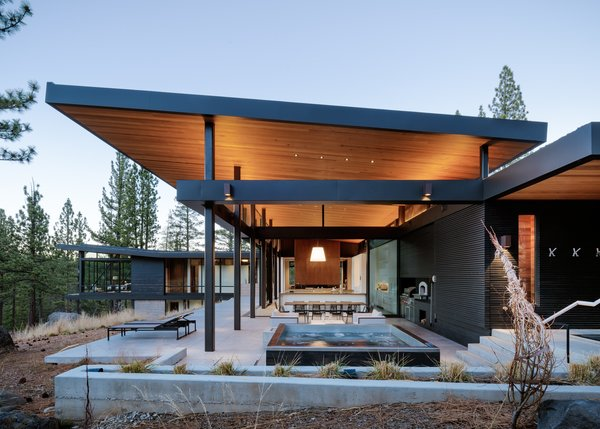 Modern home with outdoor, flowers, trees, back yard, hanging lighting, large patio, porch, deck, concrete patio, porch, deck, and small pool. Outdoor Patio Photo 5 of Martis Camp Residence 1