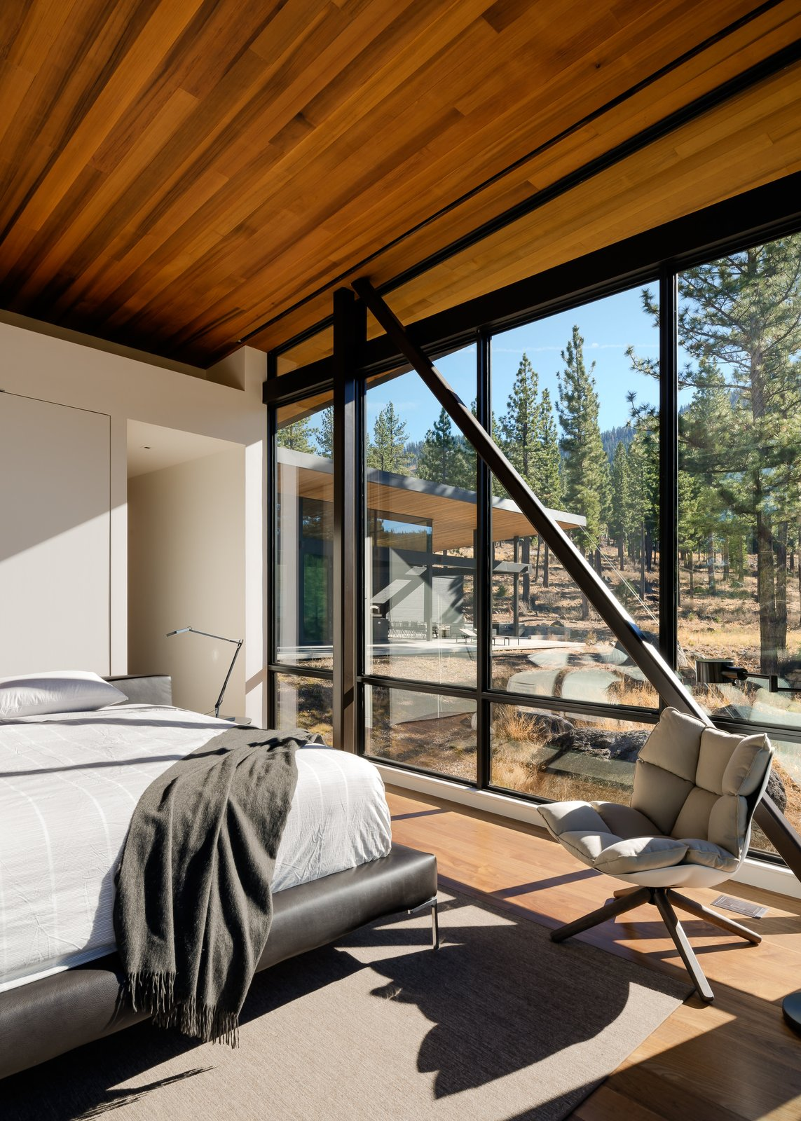 Master Bedroom Tagged: Bedroom, Bed, Chair, and Light Hardwood Floor.  Martis Camp Residence 1 by John Maniscalco Architecture