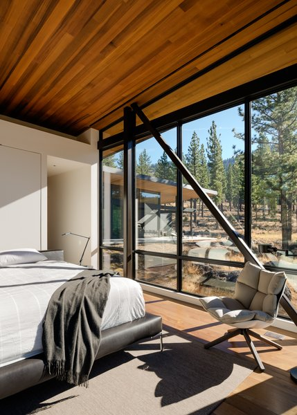 Modern home with bedroom, bed, chair, and light hardwood floor. Master Bedroom Photo 9 of Martis Camp Residence 1