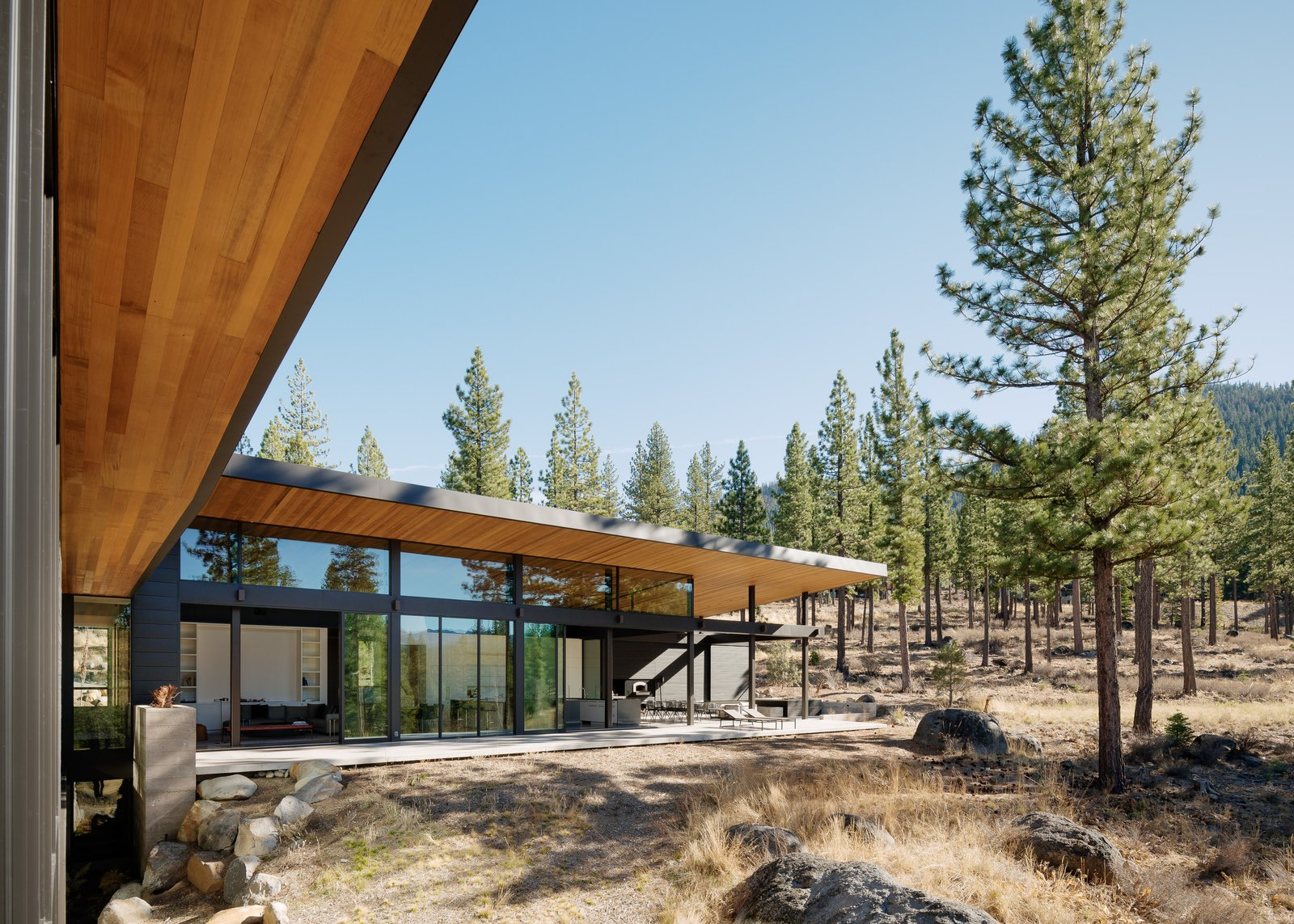 Living & Dining Patio Tagged: Outdoor, Back Yard, Large Patio, Porch, Deck, and Boulders.  Martis Camp Residence 1 by John Maniscalco Architecture