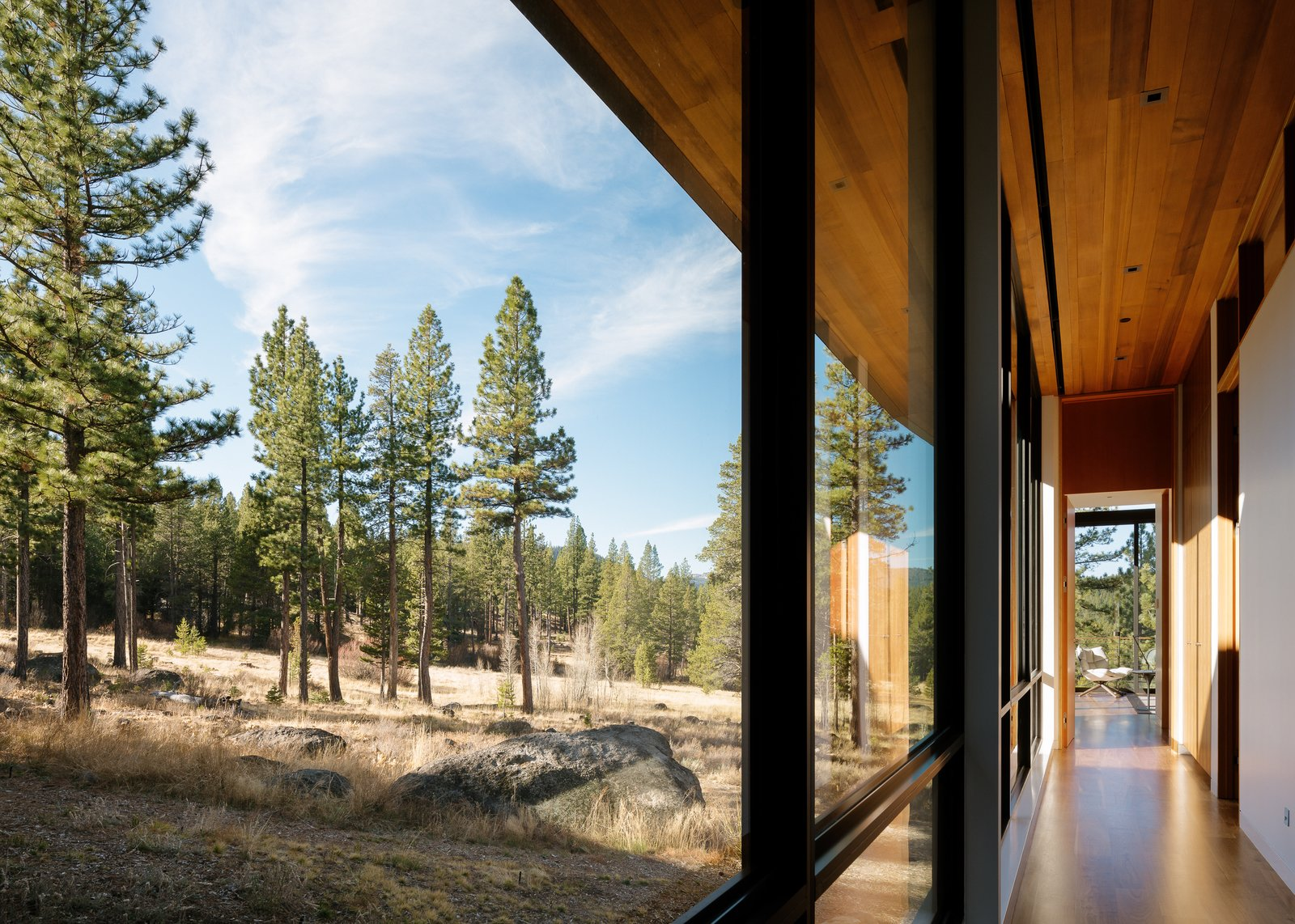 Master Bedroom Hallway Tagged: Hallway and Concrete Floor. Martis Camp Residence 1 by John Maniscalco Architecture